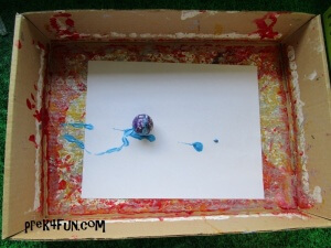 My Many Colored Days Window Art drop one ball at a time into box.Hold the box and move to paint.
